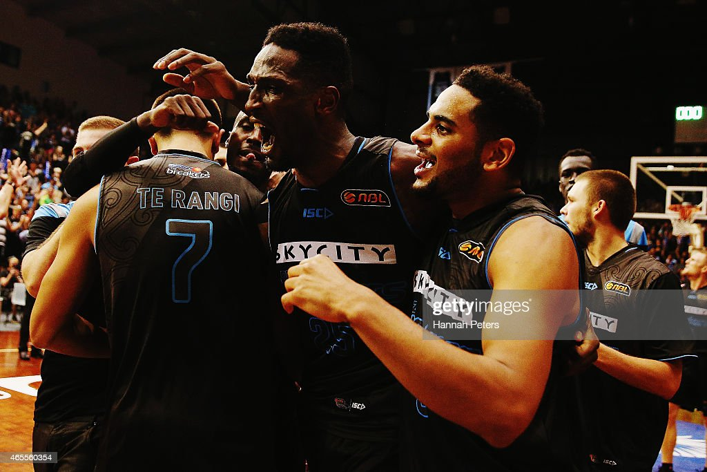 Ekene Ibekwe of the Breakers celebrates with Corey Webster of the Breakers after making the winning hsot to win game two of the NBL Grand Final series between the New Zealand Breakers and the Cairns Taipans at North Shore Events Centre on March 8, 2015 in Auckland, New Zealand.