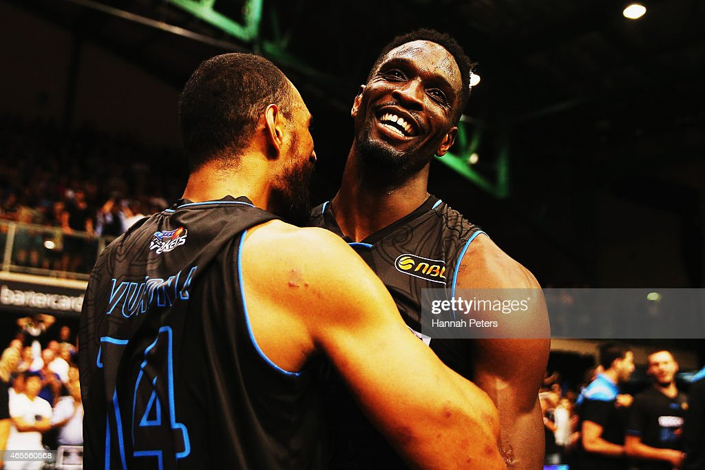Ekene Ibekwe of the Breakers celebrates with Mika Vukona of the Breakers after winning game two of the NBL Grand Final series between the New Zealand Breakers and the Cairns Taipans at North Shore Events Centre on March 8, 2015 in Auckland, New Zealand.