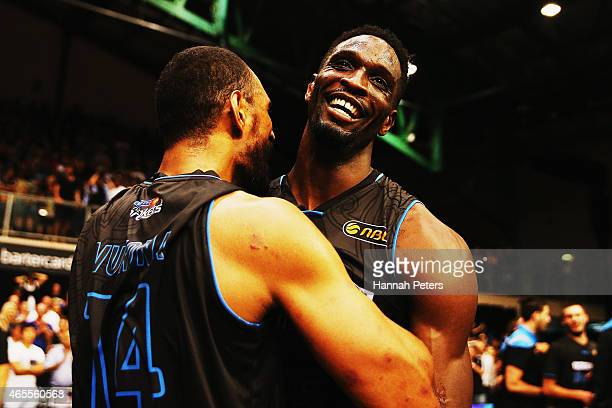 Ekene Ibekwe of the Breakers celebrates with Mika Vukona of the Breakers after winning game two of the NBL Grand Final series between the New Zealand...