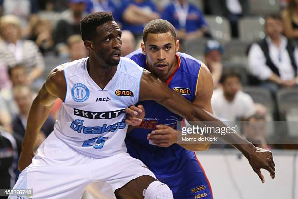Ekene Ibekwe of the Breakers competes with Daequon Montreal of the 36ers during the round four NBL match between the Adelaide 36ers and the New...