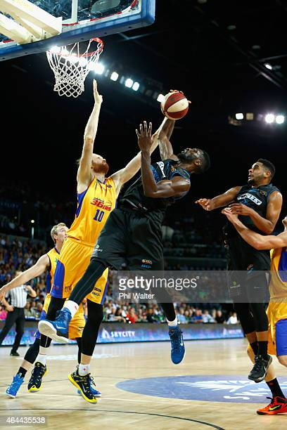 Ekene Ibekwe of the Breakers contests the rebound with Luke Schenscher of Adelaide during game one of the NBL Finals series between the New Zealand...