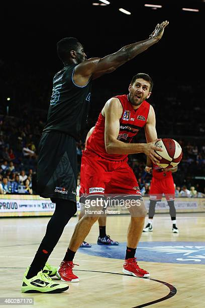 Ekene Ibekwe of the Breakers defends over the top of Tom Jervis of the Wildcats during the round 10 NBL match between the New Zealand Breakers and...