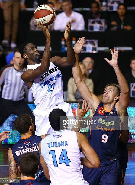 Ekene Ibekwe of The Breakers shoots over the defence of Mitch Young of the Taipans during the round three NBL match between the New Zealand Breakers...