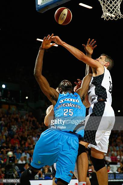 Ekene Ibekwe of the NZ Breakers shoots under pressure from Daniel Kickert of Melbourne United during the round 15 NBL match between the New Zealand...