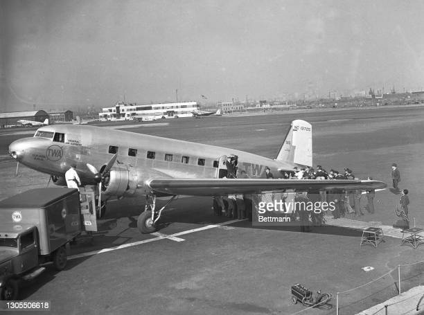 """Ekins is seen here stepping from a TWA """"Sky Chief"""" at Newark, New Jersey, less thank 18 days after embarking on the zeppelin Hindenburg at the start..."""