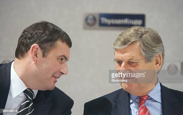 Ekkehard Schulz, chief executive officer of ThyssenKrupp AG, right speaks with Juergen Claassen, head of corporate communications, during a press...