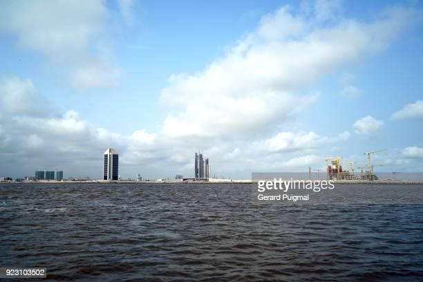 eko atlantic coastal city being built on victoria island adjacent to lagos, nigeria - atlantic ocean stock pictures, royalty-free photos & images