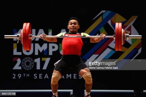 Eko Yuli Irawan of Indonesia lifts in the snatch category of the men's 62kg weightlifting final at Mitec as part of the 2017 SEA Games on August 28...