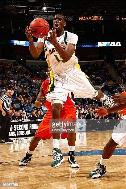 Ekpe Udoh of the Baylor Bears grabs a rebound against the Sam Houston State Bearkats during the first round of the 2010 NCAA men's basketball...