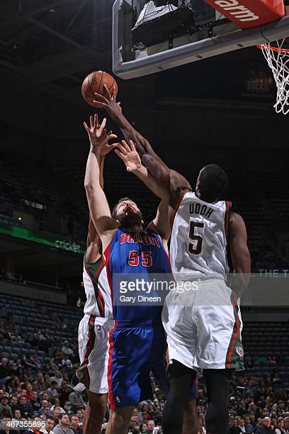 Ekpe Udoh of the Milwaukee Bucks grabs the rebound against Josh Harrellson of the Detroit Pistons on December 4 2013 at the BMO Harris Bradley Center...
