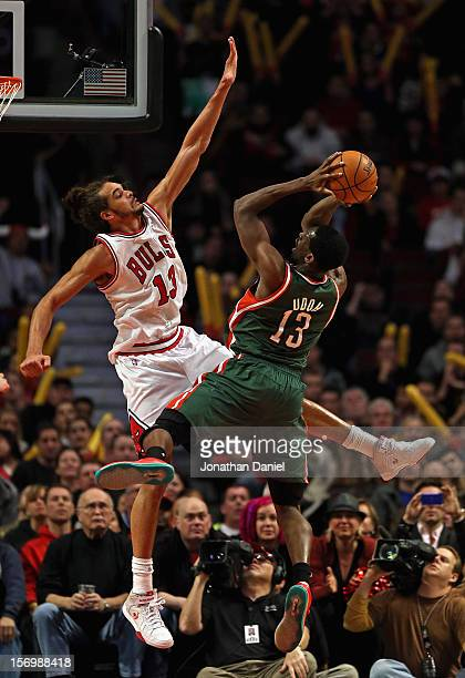 Ekpe Udoh of the Milwaukee Bucks puts up a shot against Joakim Noah of the Chicago Bulls at the United Center on November 26 2012 in Chicago Illinois...