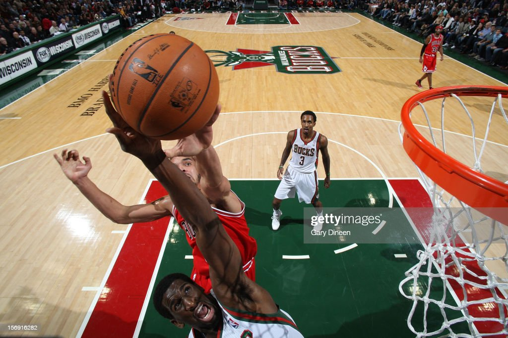 Ekpe Udoh #13 of the Milwaukee Bucks reaches for a rebound against Joakim Noah #13 of the Chicago Bulls during the NBA game on November 24, 2012 at the BMO Harris Bradley Center in Milwaukee, Wisconsin.