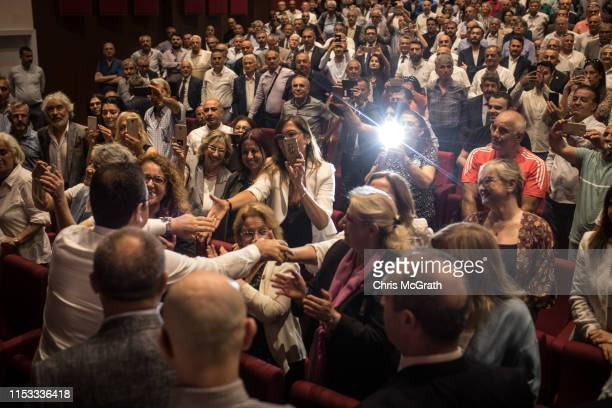 Ekrem Imamoglu CHP Party candidate for mayor of Istanbul greets supporters as he arrives to speak at a cultural center during campaigning in the...