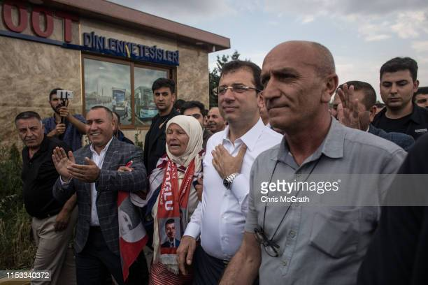 Ekrem Imamoglu CHP Party candidate for mayor of Istanbul is cheered by supporters as he arrives at a public bus depot to give a speech during...