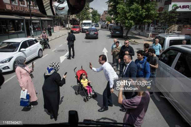 Ekrem Imamoglu CHP Party candidate for mayor of Istanbul poses for a picture in the street after supporters stopped his campaign bus during...
