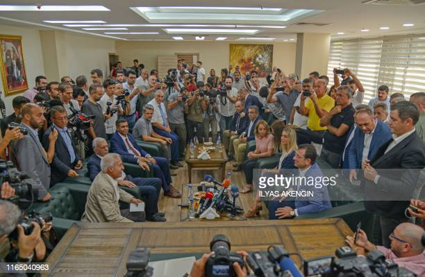 Ekrem Imamoglu , the new Mayor of Istanbul from Turkey's main opposition opposition Republican People's Party talks to the removed mayor of...