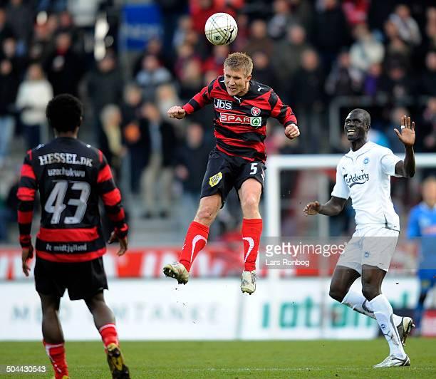 Ekstra Bladet Cup, semifinale - Martin Albrechtsen, FCM FC Midtjylland - Njogu Demba-Nyrén, OB Odense. © Lars Rønbøg / Frontzonesport