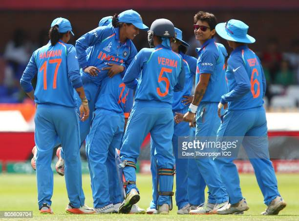 Ekta Bisht of India is lifted off the ground by team mates after taking the wiglet of Sidra Nawaz of Pakistan during the ICC Women's World Cup match...