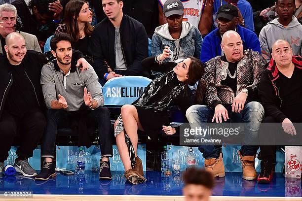 Ektor Rivera Ana Villafane and Fat Joe attend New York Knicks vs Washington Wizards preseason game at Madison Square Garden on October 10 2016 in New...
