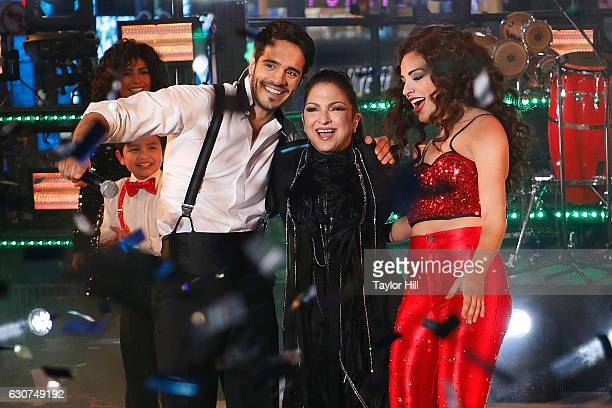 Ektor Rivera Gloria Estefan and Ana Villafane perform during Dick Clark's New Year's Rockin' Eve at Times Square on December 31 2016 in New York City