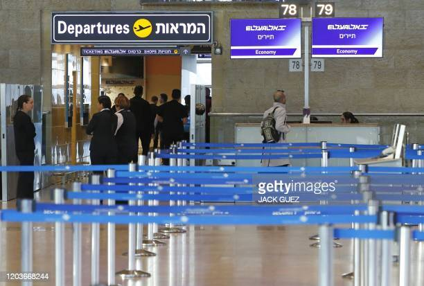 El Al Israel Airlines departure counter is pictured empty after it cancelled flights to Italy at Ben Gurion International Airport, near Tel Aviv, on...