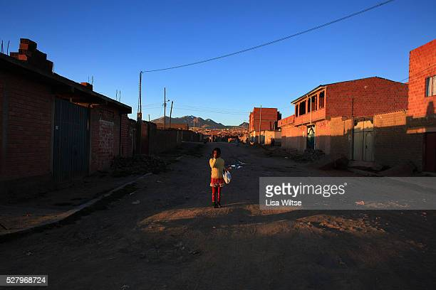Rosa Cusi stands in the eveing light in El Alto La Paz's sister city El Alto located above the Bolivian capital with nearly one million people was a...
