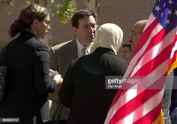El Cajon Mar 19 2003 ––– John Kingston center FBI Special agent Incharge talks to Naama family after meeting with Iraqi community in El Cajon Esra...