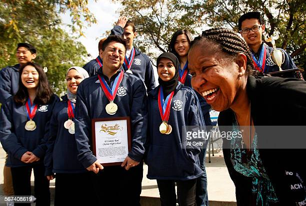 El Camino Real Charter High School English teacher Stephanie Franklin right in her sixth year as El Camino's coach has fun with the eight students of...