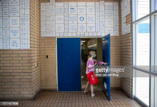 El Camino Real Charter High School sophomore Mackenzie Wise walks out to clean out her PE locker at on Thursday April 30 2020 in Woodland Hills CA...