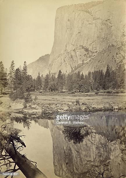 El Capitan a vertical rock formation in Yosemite Valley Yosemite National Park California reflected in water circa 1865