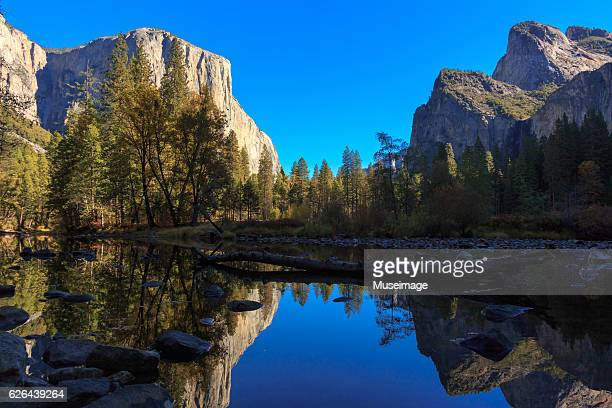 el capitan the salathé and bridal fall reflect on merced river - el capitan yosemite national park stock pictures, royalty-free photos & images