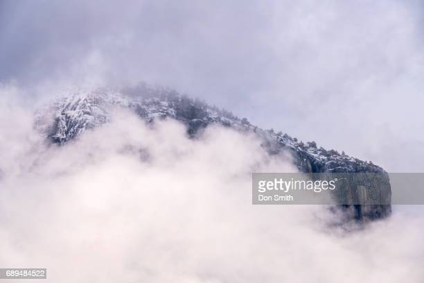 el capitan through clouds - don smith stock pictures, royalty-free photos & images