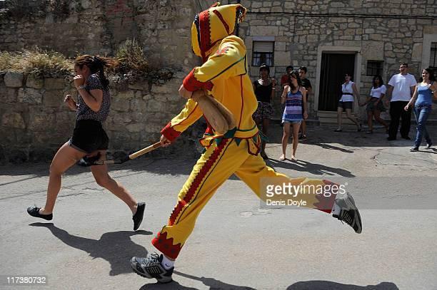 El Colacho a representation of the devil chases children through the streets during the festival of El Colacho on June 26 2011 in Castrillo de Murcia...