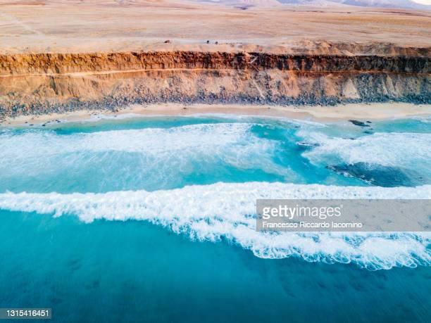 el cotillo coastline and blue waves in fuerteventura, canary islands, spain. aerial view - francesco riccardo iacomino spain foto e immagini stock