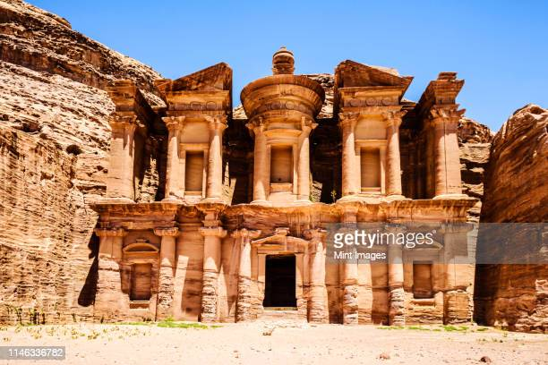 el deir building carved into cliff face, petra, jordan, jordan - treasury stock pictures, royalty-free photos & images