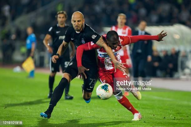 El Fadou Ben of Crvena Zvezda competes against Nemanja Miletic of Partizan during the Semifinal Serbian Cup match between Red Star Belgrade and...