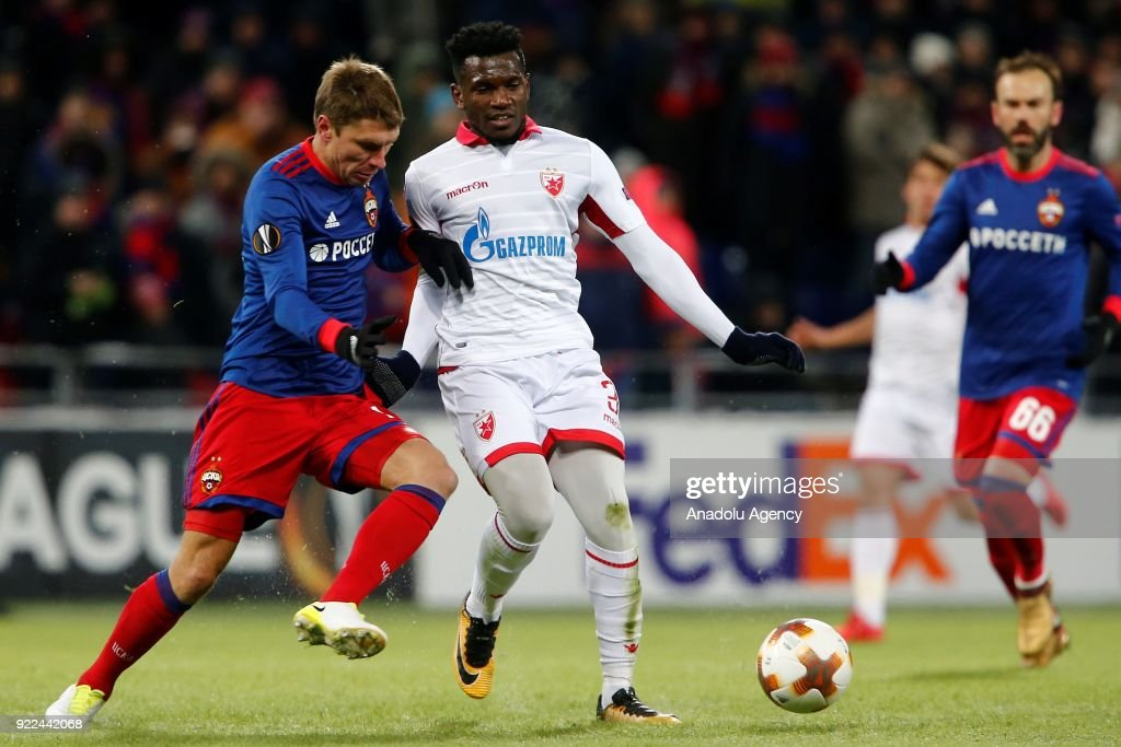 El Fardou Ben Mohamed (C) of Crvena Zvezda in action against Kirill Nababkin (L) of CSKA Moscow during the UEFA Europa League round of 32, second leg soccer match between CSKA Moscow and Crvena Zvezda at the Stadium CSKA Moscow in Moscow, Russia on February 21, 2018.