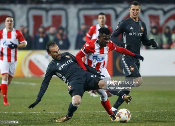 El Fardou Ben Nabouhane of Crvena Zvezda competes for the ball against Alan Dzagoev of CSKA Moscow during the UEFA Europa League Round of 32 match...