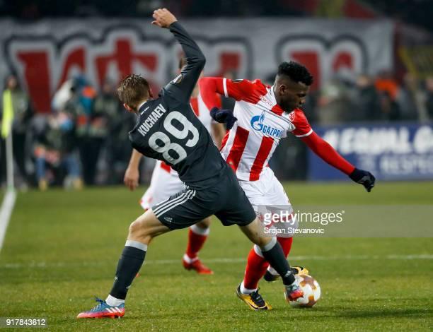 El Fardou Ben Nabouhane of Crvena Zvezda in action against Konstantin Kuchaev of CSKA Moscow during UEFA Europa League Round of 32 match between...