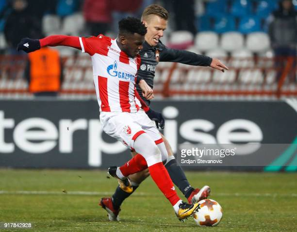 El Fardou Ben Nabouhane of Crvena Zvezda in action against Pontus Wernbloom of CSKA Moscow during UEFA Europa League Round of 32 match between Crvena...