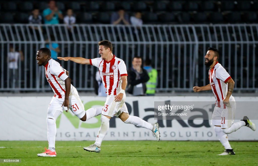 El Fardou Ben Nabouhane (L) of Olympiacos celebrate scoring the goal with Leonardo Koutris (C) and Manolis Siopis (R) during the UEFA Champions League Qualifying match between FC Partizan and Olympiacos on July 25, 2017 in Belgrade, Serbia.