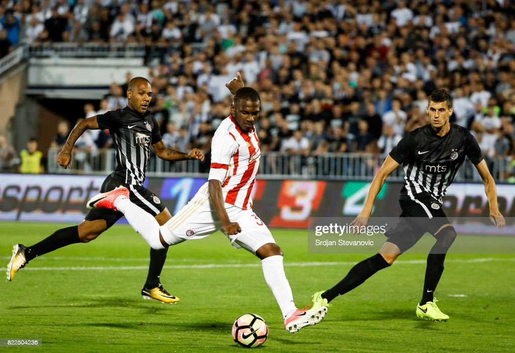 El Fardou Ben Nabouhane (C) of Olympiacos scores the goal near Lazar Cirkovic (R) and Everton (L) of Partizan during the UEFA Champions League Qualifying match between FC Partizan and Olympiacos on July 25, 2017 in Belgrade, Serbia.