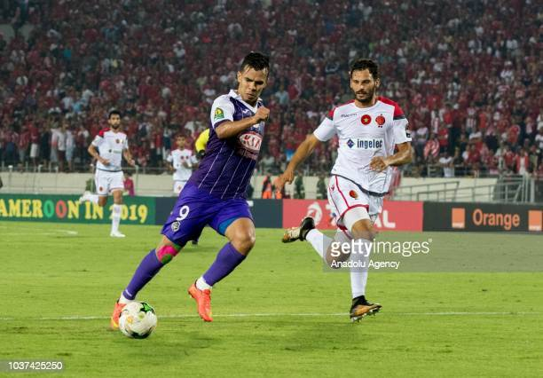 El Habib Bouguelmouna of Es Setif in action against Naim Aarab of WAC Casablanca during the CAF Champions League Quarter Final Match between WAC...