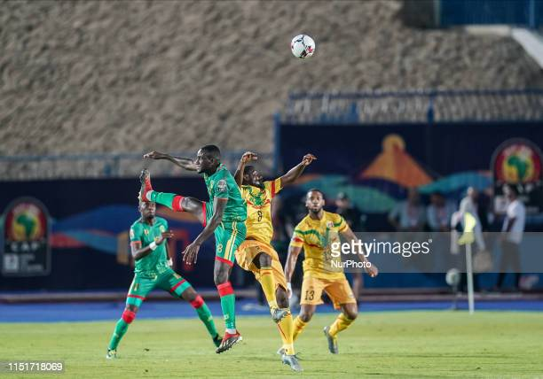 El Hacen El Id of Mauritania and Diadie Samassekou of Mali challenging for the ball during the 2019 African Cup of Nations match between Mali and...