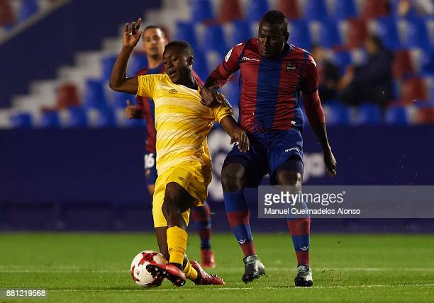 El Hacen of Levante competes for the ball with Marlos Moreno of Girona during the Copa del Rey Round of 32 Second Leg match between Levante and...