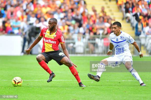 El Hadji Ba of Lens and Ahmed Kashi of Troyes during the French Ligue 2 match between RC Lens and Troyes at Stade BollaertDelelis on August 18 2018...