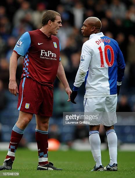 El Hadji Diouf of Blackburn Rovers and Richard Dunne of Aston Villa exchange views during the Barclays Premier League match between Blackburn Rovers...