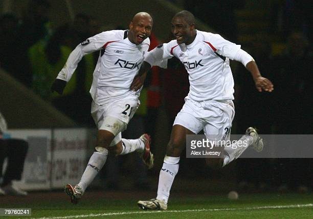 El Hadji Diouf of Bolton Wanderers celebrates scoring the first goal with team mate Jlloyd Samuel during the UEFA Cup Round of 32 First Leg match...