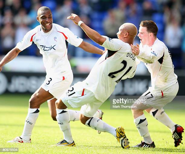 El Hadji Diouf of Bolton Wanderers celebrates with team mates Jlloyd Samuel and Danny Guthrie after scoring the opening goal during the Barclays...