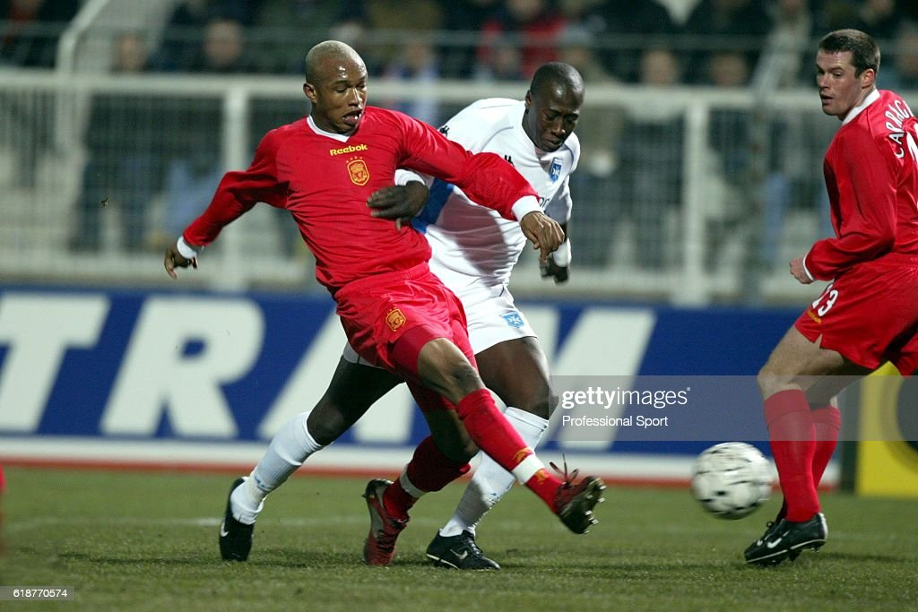 El Hadji Diouf of Liverpool (left) in action during the UEFA Cup fourth round, 1st leg, match between AJ Auxerre and Liverpool at the Abbe-Deschamps Stadium, Auxerre, France on February 20, 2003.